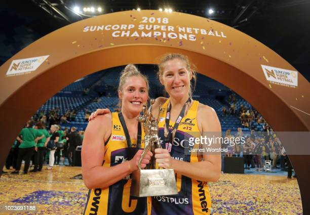 Laura Scherian and Jacqui Russell of the Sunshine Coast Lightning pose for a photo with their championship trophy after their win Super Netball Grand...