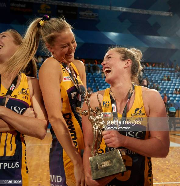 Laura Scherian and Steph Wood of the Sunshine Coast Lightning share a laugh after their Super Netball Grand Final match between the the Fever and the...