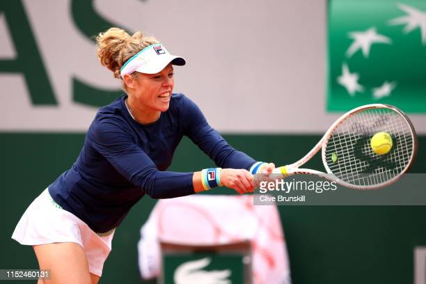 Laura Seigmund of Germany plays a backhand during her ladies singles second round match against Belinda Bencic of Switzerland during Day four of the...
