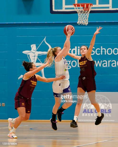 Laura Shanahan Rose Harvey and Isabel Bunyan are seen in action during the Women's British Basketball League match between WBBL Cardiff Archers and...