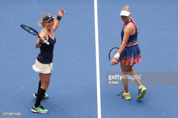 Laura Siegemund of Germany and Vera Zvonareva of Russia celebrate winning match point during their Women's Doubles final match against Nicole...