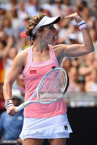 Laura Siegemund of Germany celebrates after winning match point in her first round match against Victoria Azarenka of Belarus during day two of the...
