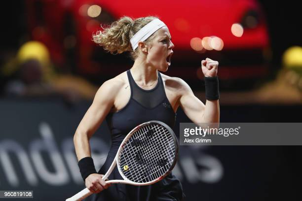 Laura Siegemund of Germany celebrates after winning the first set of her match against Barbora Strycova of Czech Republic during day 2 of the Porsche...