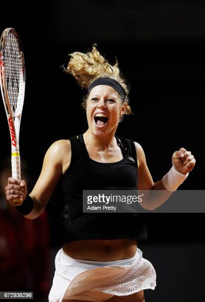 Laura Siegemund of Germany celebrates match point in her match against Zhang Shuai of China during the Porsche Tennis Grand Prix at Porsche Arena on...