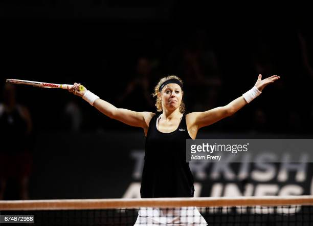 Laura Siegemund of Germany celebrates winning match point against Simona Halep of Romania during the Porsche Tennis Grand Prix at Porsche Arena on...