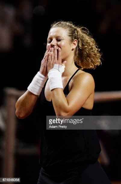 Laura Siegemund of Germany celebrates winniong match point during her match against Karolina Pliskova of the Czech Republic during the Porsche Tennis...