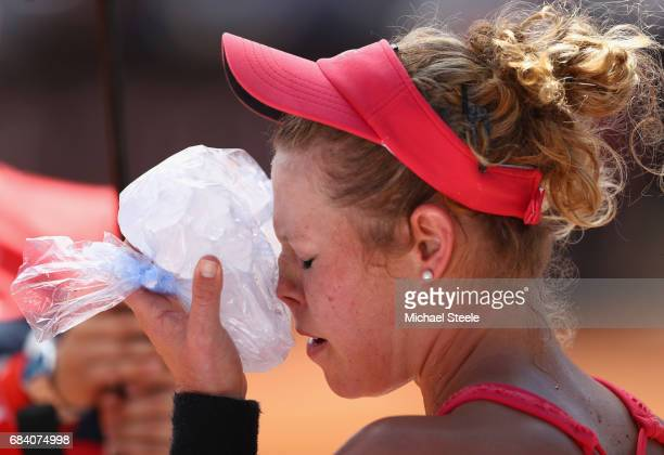 Laura Siegemund of Germany cools down with an ice pack during her second round match against Simona Halep of Romania on Day Four of The...