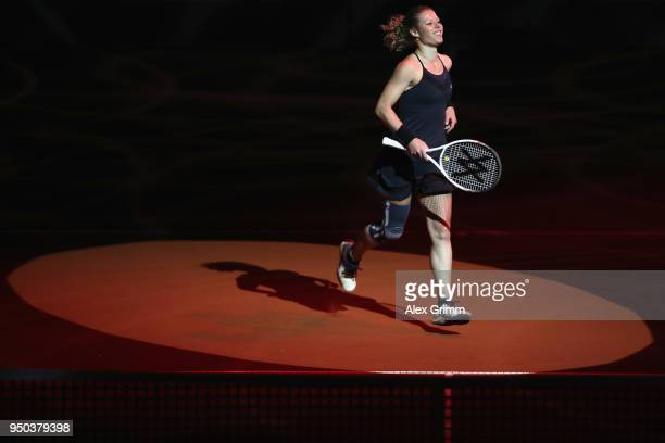 Laura Siegemund of Germany enters the court for a show event on day 1 of the Porsche Tennis Grand Prix at PorscheArena on April 23 2018 in Stuttgart...