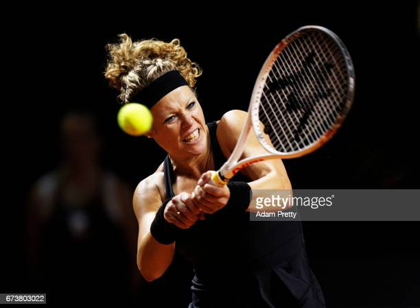 Laura Siegemund of Germany plays a backhand during her match against Svetlana Kuznetsova of Russia during the Porsche Tennis Grand Prix at Porsche...