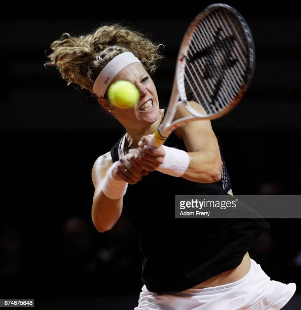 Laura Siegemund of Germany plays a backhand during her match against Simona Halep of Romania during the Porsche Tennis Grand Prix at Porsche Arena on...