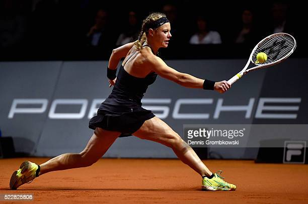 Laura Siegemund of Germany plays a backhand in her match against Simona Halep of Romania during Day 4 of the Porsche Tennis Grand Prix at...
