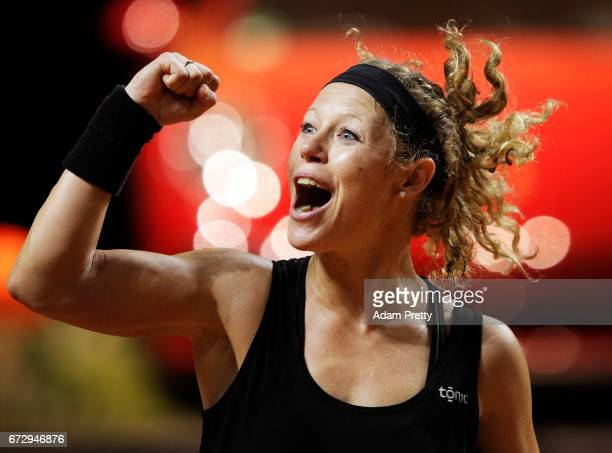 Laura Siegemund of Germany plays a backhand in her match against Zhang Shuai of China during the Porsche Tennis Grand Prix at Porsche Arena on April...