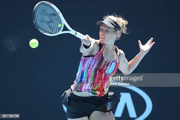 Laura Siegemund of Germany plays a forehand in her first round match against Jelena Jankovic of Slovakia on day one of the 2017 Australian Open at...