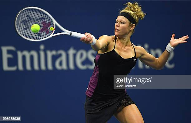 Laura Siegemund of Germany returns a shot to Venus Williams of the United States during her third round Women's Singles match on Day Six of the 2016...