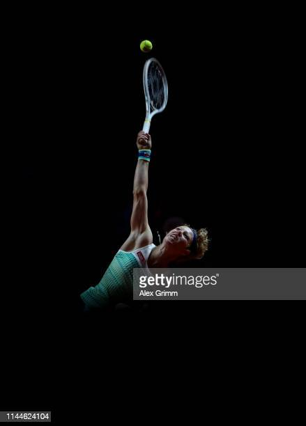 Laura Siegemund of Germany serves the ball to Lesia Tsurenko of Ukraine during their first round match on day 2 of the Porsche Tennis Grand Prix at...