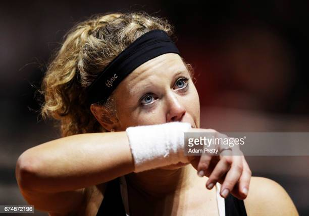 Laura Siegemund of Germany sheds a tear as she celebrates winning match point against Simona Halep of Romania during the Porsche Tennis Grand Prix at...