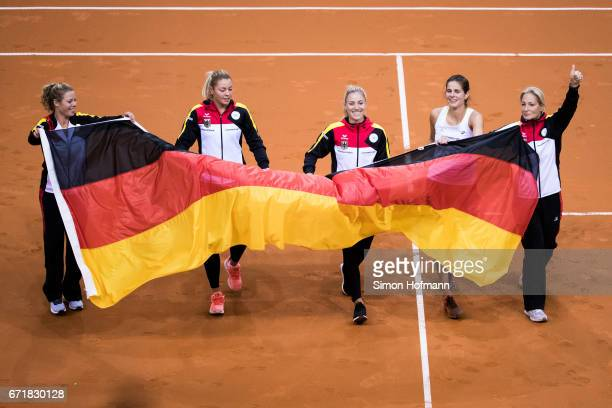 Laura Siegmund, Carina Witthoeft, Angelique Kerber, Julia Goerges and Barbara Rittner of Germany celebrate victory during the FedCup World Group...