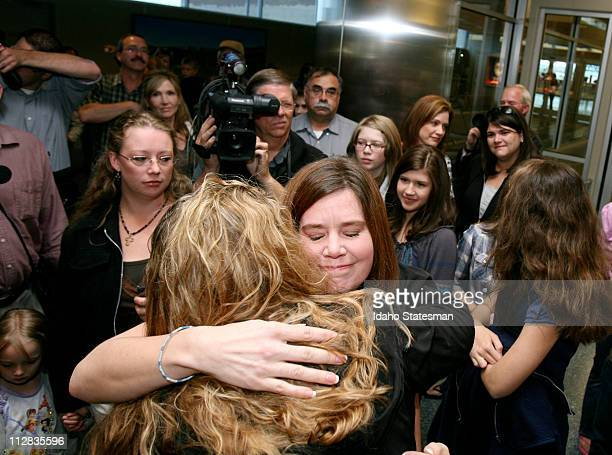Laura Silsby center facing of Meridian Idaho arrives at the Boise airport on Tuesday May 18 2010 after spending 3 1/2 months behind bars in Haiti She...