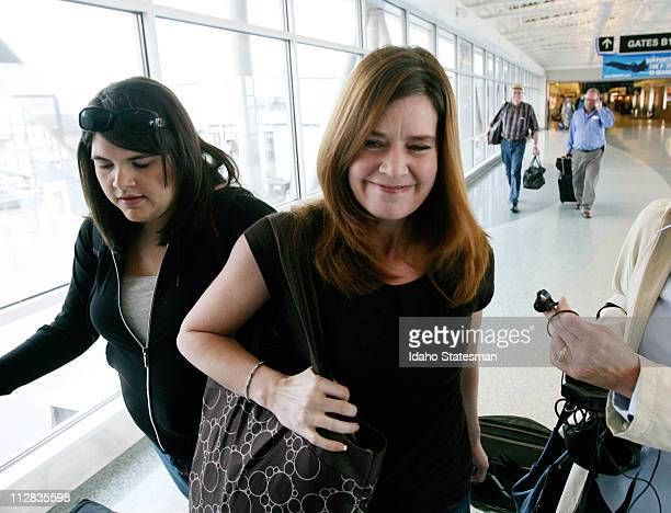 Laura Silsby center of Meridian Idaho arrives at the Boise airport on Tuesday May 18 2010 after spending 3 1/2 months behind bars in Haiti She was...