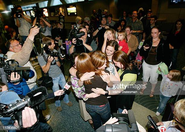 Laura Silsby of Meridian Idaho is greeted by friends and family after arriving at the Boise airport on Tuesday May 18 2010 after spending 3 1/2...
