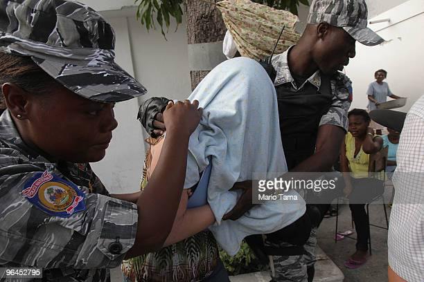 Laura Silsby the head of New Life Children's Refuge of Boise Idaho accused of child trafficking is escorted by Haitian national police while...
