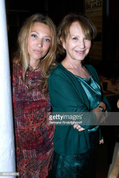 Laura Smet and her mother Nathalie Baye attend the Dinner in honor of Nathalie Baye at La Chope des Puces on April 30, 2018 in Saint-Ouen, France.