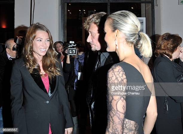 Laura Smet Johnny Hallyday and wife Laetitia attend the Patrick Demarchelier's exhibition Party on September 29 2008 in Paris France