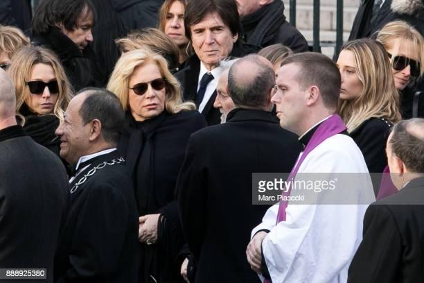 Laura Smet Sylvie Vartan Ilona Smet and Estelle Lefebure are seen during Johnny Hallyday's funerals at Eglise De La Madeleine on December 9 2017 in...