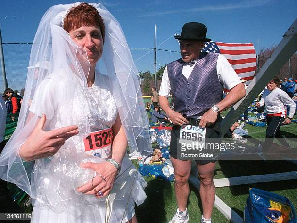 Laura Snider and Pat Duprey get ready to run the Boston Marathon in a custommade bridal gown from Danielle's Bridal Boutique in Saratoga Springs NY...