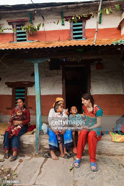 Laura Spero visits with her Nepali nephews Aidan and Pascal Dahal on their grandmother Radhika Subedi's porch The boys' mother Malika Subedi hold's a...