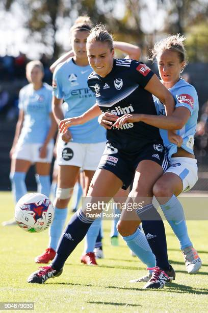 Laura Spiranovic of Melbourne Victory and Aivi Luik of Melbourne City contest the ball during the round 11 WLeague match between the Melbourne...