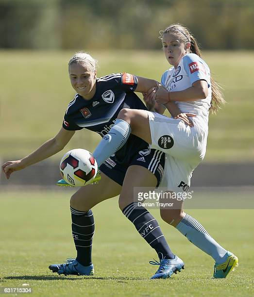 Laura Spiranovic of Melbourne Victory and Amy Jackson of Melbourne City compete for the ball during the round 12 WLeague match between Melbourne...