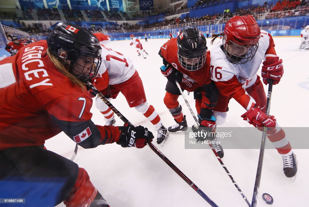 Laura Stacey #7 and Bailey Bram #17 of Canada battle for the puck with Yekaterina Nikolayeva #76 of Olympic Athlete from Russia in the second period during the Women's Ice Hockey Preliminary Round - Group A game on day two of the PyeongChang 2018 Winter Olympic Games at Kwandong Hockey Centre on February 11, 2018 in Gangneung, South Korea.