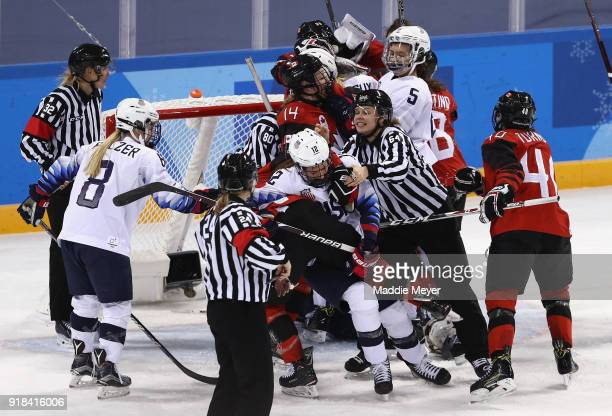 Laura Stacey of Canada and Kelly Pannek of the United States get tangled up as the referee tries to separate them late in the game during the Women's...