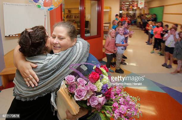 Laura Stevens, a teacher at James Otis Kaler Elementary School, gets a hug from Principal Bonnie Hicks while receiving a schoolwide welcome home on...