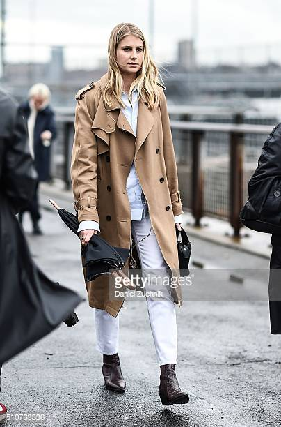 Laura Stoloff is seen outside the Coach show wearing a beige rain coat during New York Fashion Week Women's Fall/Winter 2016 on February 16 2016 in...