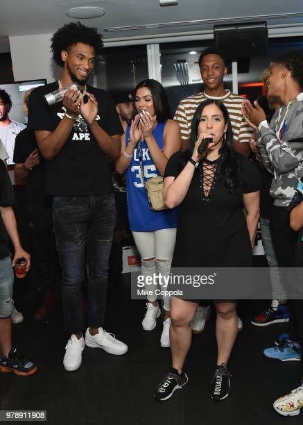 Laura Stylez presents 2018 NBA Draft prospect Marvin Bagley III with a customized pair of JBL Everest 700 headphones at the JBL x MB3 Draft Party...