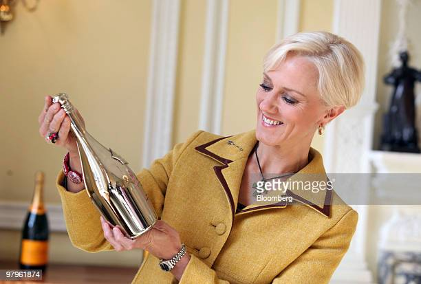Laura Tenison, founder and managing director of JoJo Maman Bebe, holds the Veuve Clicquot Award at a presentation in London, U.K., on Tuesday, March...