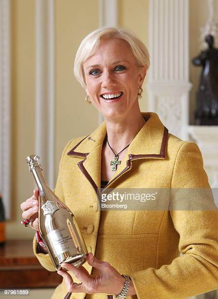 Laura Tenison founder and managing director of JoJo Maman Bebe holds the Veuve Clicquot Award at a presentation in London UK on Tuesday March 23 2010...