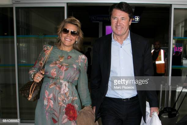 Laura Tenoudji and Christian Estrosi arrive at Nice airport during the 70th annual Cannes Film Festival at on May 17, 2017 in Cannes, France.