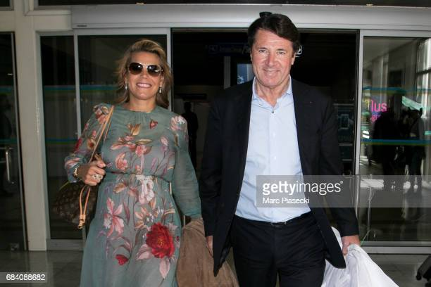 Laura Tenoudji and Christian Estrosi arrive at Nice airport during the 70th annual Cannes Film Festival at on May 17 2017 in Cannes France