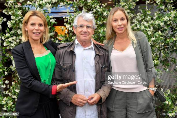 Laura Tenoudji Michel Boujenah and Charlotte Bouteloup attend the 2018 French Open Day three at Roland Garros on May 29 2018 in Paris France