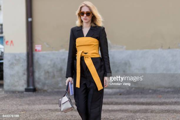 Laura Tonder wearing a black suit yellow corset outside Missoni during Milan Fashion Week Fall/Winter 2017/18 on February 25 2017 in Milan Italy