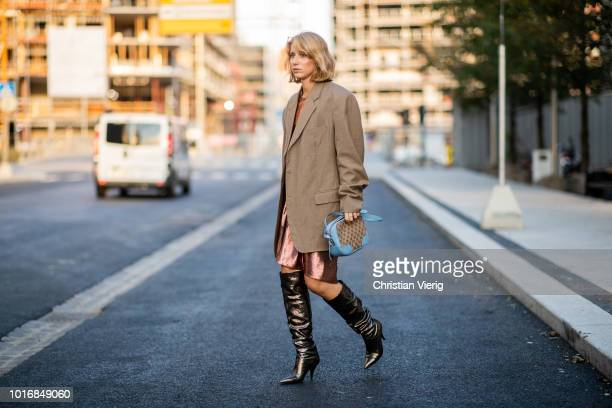 Laura Tonder wearing boots Louis Vuitton bag brown blazer seen outside Iben during Oslo Runway SS19 on August 14 2018 in Oslo Norway