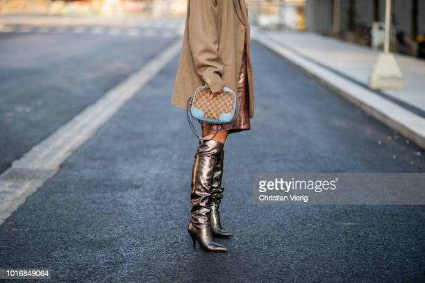 Laura Tonder wearing boots Louis Vuitton bag, brown blazer seen outside Iben during Oslo Runway SS19 on August 14, 2018 in Oslo, Norway.