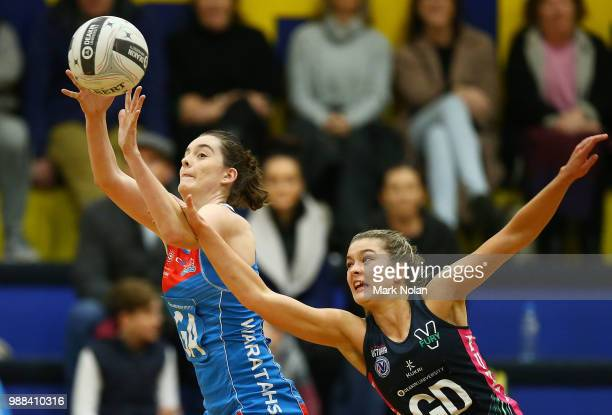 Laura Towell of the Waratahs and Allie Smith of the Fury contest possession during the Australian Netball League third place playoff between the NSW...