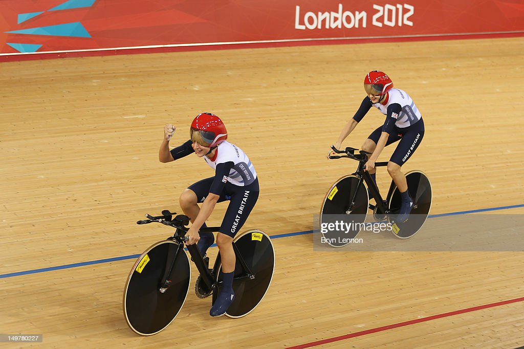Laura Trott (L) and Joanna Rowsell of Great Britain celebrate after setting a new world record in the Women's Team Pursuit Track Cycling qualifying on Day 7 of the London 2012 Olympic Games at Velodrome on August 3, 2012 in London, England.