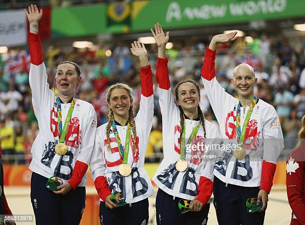 Laura Trott Joanna RowsellShand Katie Archibald Elinor Barker of Great Britain celebrate on the podium at the medal ceremony for the Women's Team...