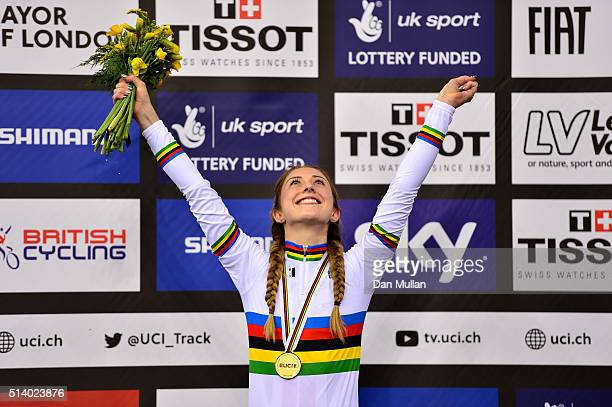 Laura Trott of Great Britain celebrates on the medal podium after winning the Women's Omnium during Day Five of the UCI Track Cycling World...