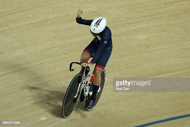 Laura Trott of Great Britain celebrates the top time during the Women's Omnium Flying Lap 56 race on Day 11 of the Rio 2016 Olympic Games at the Rio...